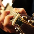 Man playing a guitar — Stock Photo #4825596
