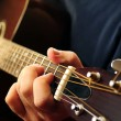 Stock Photo: Man playing a guitar