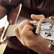 Man playing a guitar - Stock Photo
