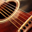 Stock Photo: Old guitar close up