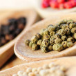 Assorted peppercorns - Stock Photo