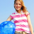 Young girl with beach ball — Stock fotografie #4825993