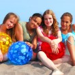 Four girls on a beach - Stock Photo