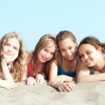 Four girls on a beach — Stock Photo