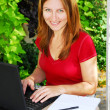 Foto Stock: Woman working at home