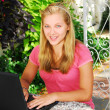 Girl with computer — Stockfoto #4826159