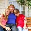 Family at a house — Stock Photo #4826172