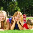 Family relaxing in a park — Stock Photo