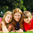 Family relaxing in a park - 