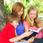 Family reading a book — Stock Photo #4826180