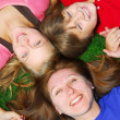 Family lying down on grass — Stock Photo
