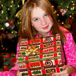 Child with Christmas present — Stock Photo #4826208