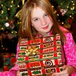 Child with Christmas present - Stockfoto