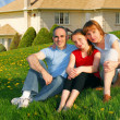Family at a house - Stock Photo