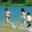 Children running into water — Stock Photo #4826308