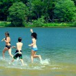 Children in a lake — Stock Photo #4826311