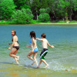 Children running into water — Stock Photo