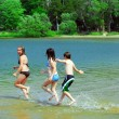 Children running into water — Stock Photo #4826312