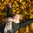 Stock Photo: Girl in a fall park