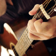 Man playing a guitar — Stock Photo