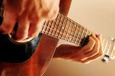 Man playing a guitar — Foto de Stock