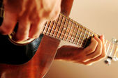 Man playing a guitar — Stock Photo