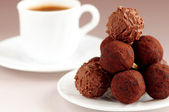Chocolate truffles and coffee — Stock Photo