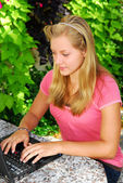 Girl with computer — Foto Stock