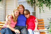 Family at a house — Stock Photo