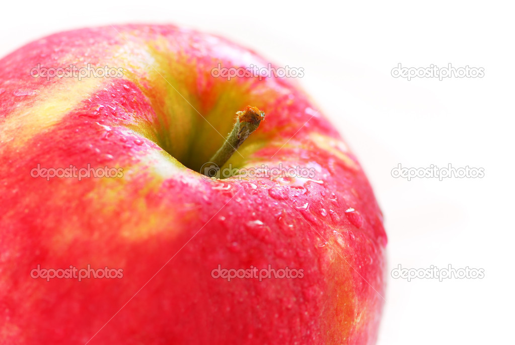 Macro of red apple with water droplets on white background  Stock Photo #4824214