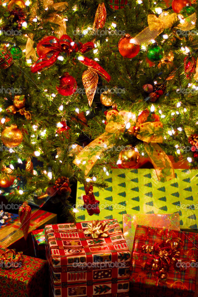 Wrapped gifts under a decorated Christmas tree  Stock Photo #4824284