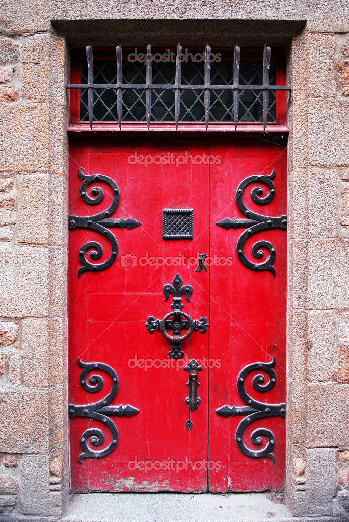 Red medieval door in Mont Saint Michel abbey in France — Stock Photo #4824425