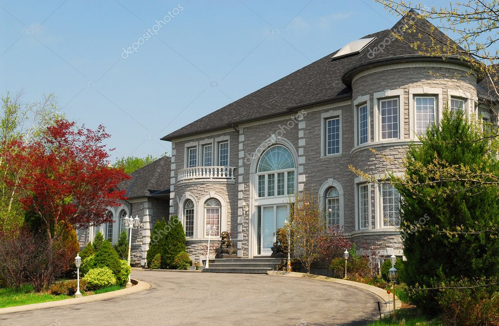 Front of a large beautiful executive home under blue sky — Stock Photo #4824523