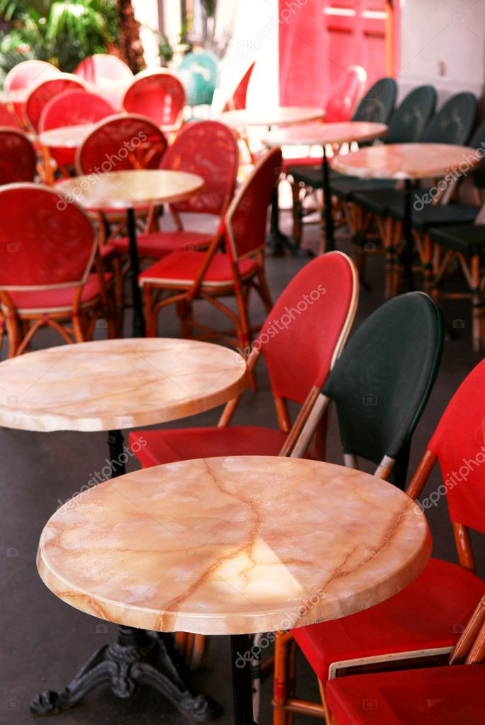 Colorful tables and chairs in sidewalk cafe. Paris, France. — Stock Photo #4824588