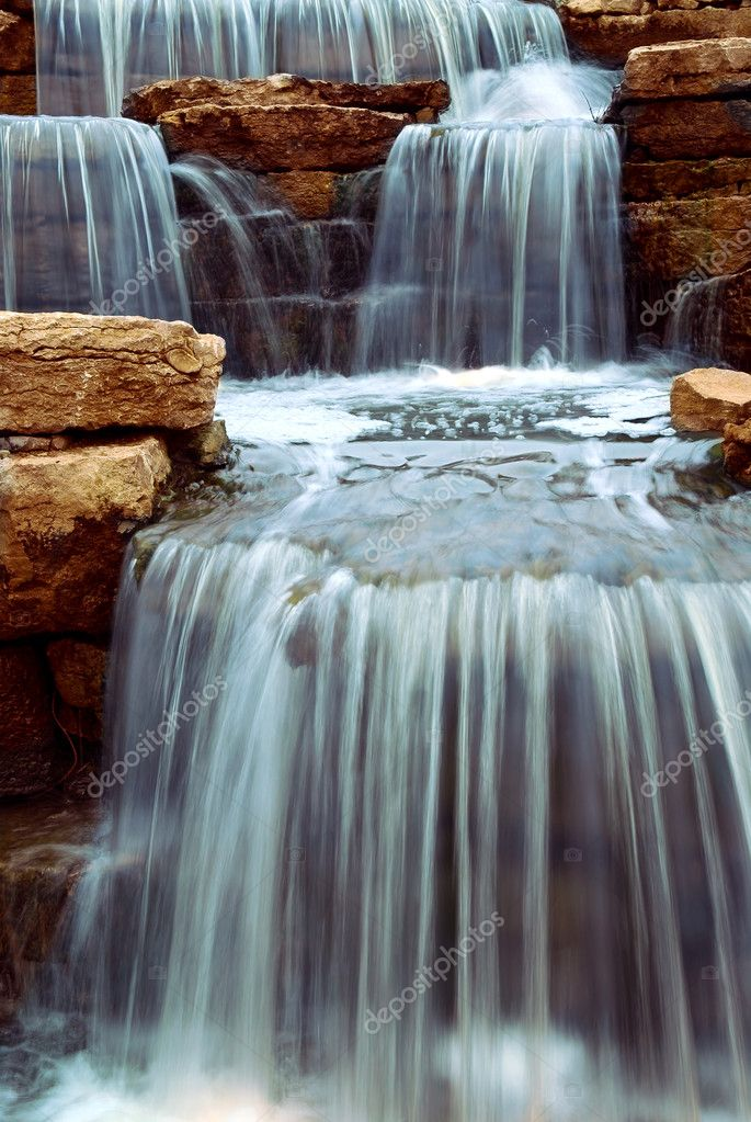 Beautiful cascading waterfall over natural rocks, landscaping element   #4824892