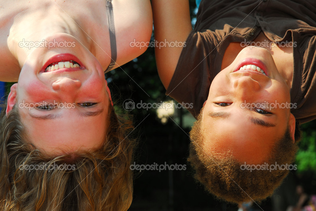 Two girls hanging upside down in a playground — Stock Photo #4826021