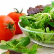 Baby greens and tomatoes — Stock Photo