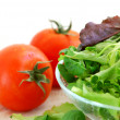Baby greens and tomatoes — Stock Photo #4947609