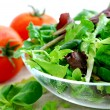 Baby greens and tomatoes — Stock Photo #4947615