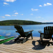 Chairs on dock — Stockfoto