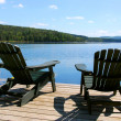 Stock Photo: Chairs on dock