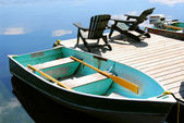 Chairs boat dock — Stock Photo