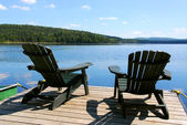 Chairs on dock — Stock Photo