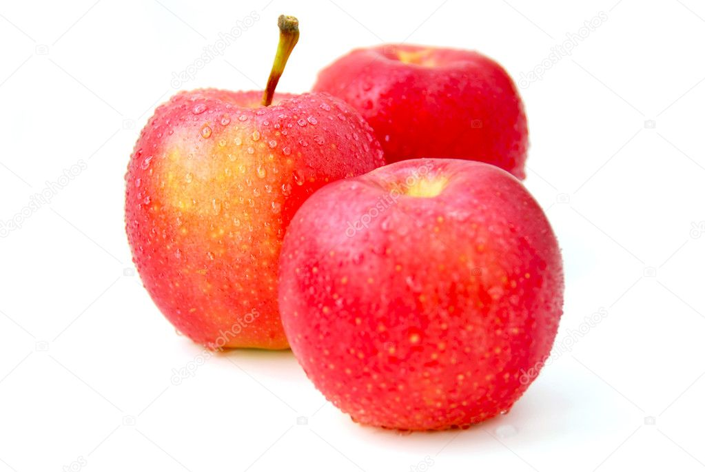 Three red apples with water droplets on white background, focus on the middle apple  Stock Photo #4947660