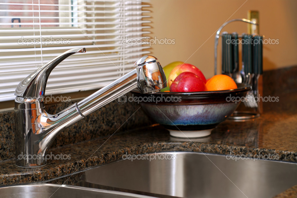 Interior of a modern kitchen with stainless steel double sink  Stock Photo #4947981