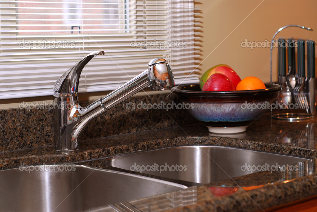 Interior of a modern kitchen with granite counter top and stanless steel double sink — Stock Photo #4947987