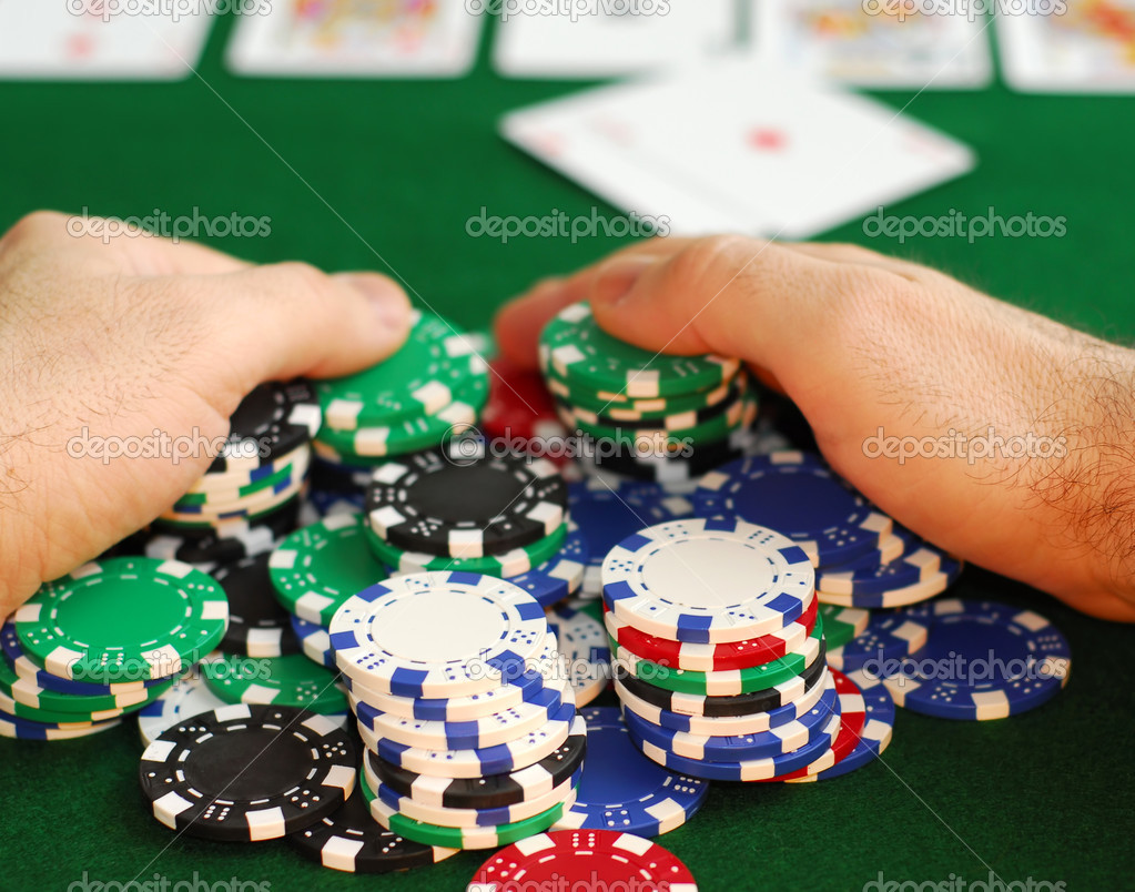 Poker player raking a big pile of chips — Stock Photo #4948215