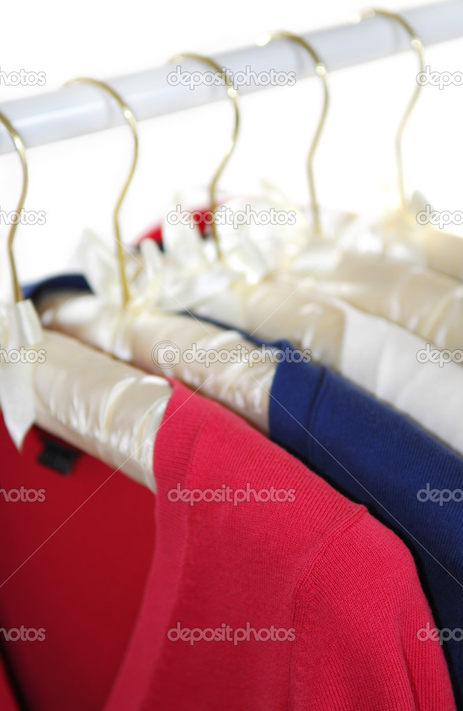 Colorful women's sweaters on a rack on padded hangers — Stock Photo #4948491