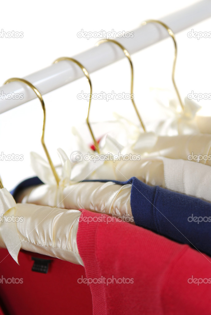 Colorful women's sweaters on a rack on padded hangers — Stock Photo #4948544