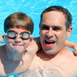 Father son pool - Stock Photo